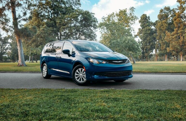 Blue 2020 Chrysler Voyager on parkway