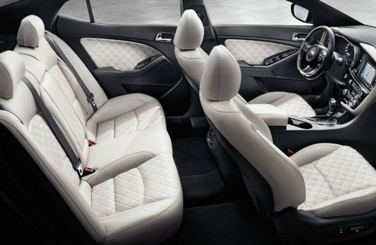 Interior view of the beige seating inside a 2015 Kia Optima