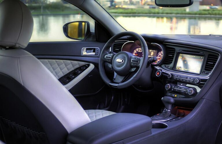 Interior view of the steering wheel and touchscreen inside a 2015 Kia Optima