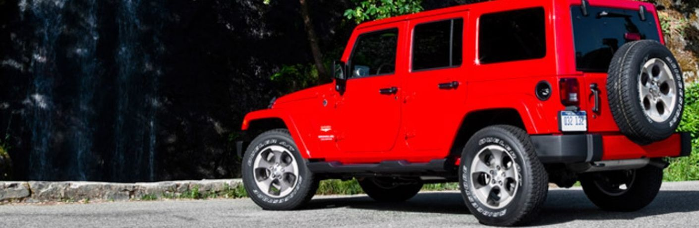 Exterior view of a red 2016 Jeep Wrangler Unlimited