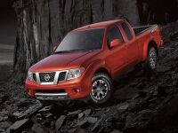 Exterior view of a red 2017 Nissan Frontier parked on a rocky hill