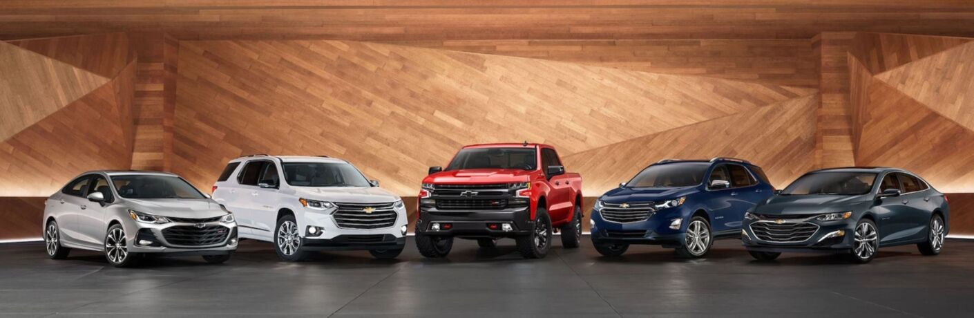 Exterior view of five 2019 Chevrolet models parked in a showroom