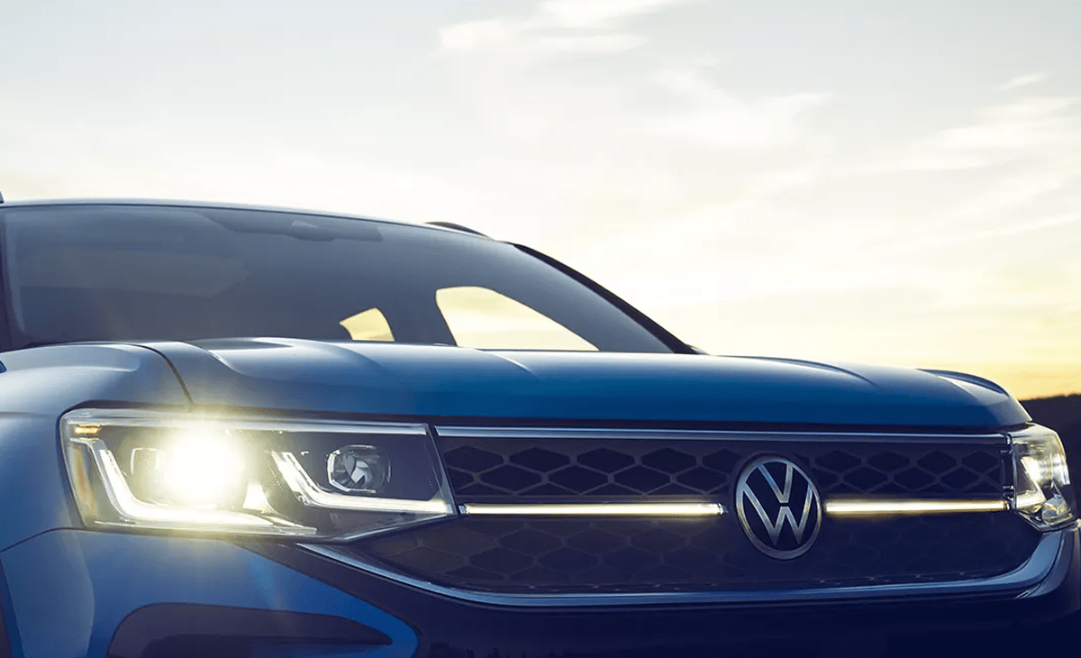 The front grille of a VW Taos at sunset.