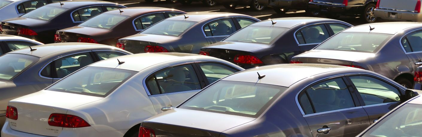 A stock photo of cars for sale at a dealership.