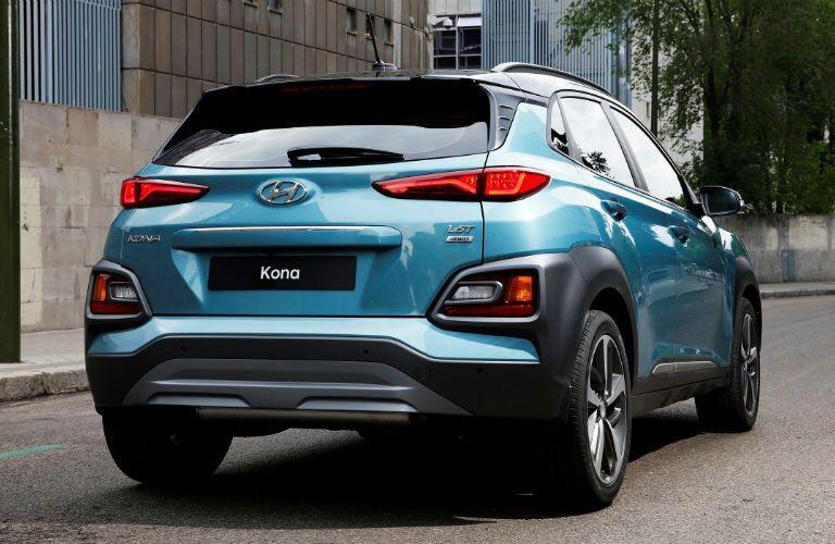 blue kona rear view in city