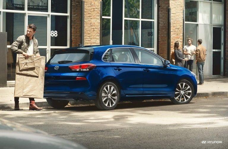 blue Hyundai Elantra GT in a city