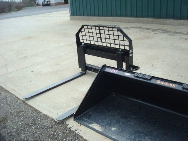 0 Z- Skid Steer Attachments Various items