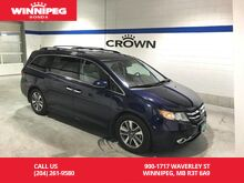 2014_Honda_Odyssey_Navigation/DVD/Power doors/Rear view camera/Heated seats/Bluetooth_ Winnipeg MB