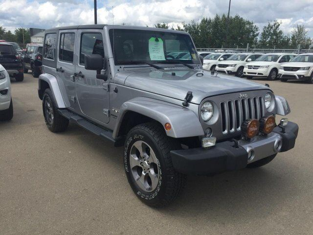 2016 Jeep Wrangler Unlimited Sahara Redwater AB